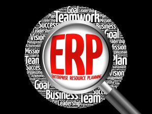 ERP - Enterprise Resource Planning word cloud with magnifying glass business concept