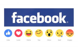 New Facebook like button 6 Empathetic Emoji Reactions printed on white paper. Facebook is a well-known social networking service.