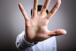 Photo No More. Stop Gesture. Man with raised opening hand making No more gesture.